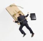 businessman-in-mousetrap
